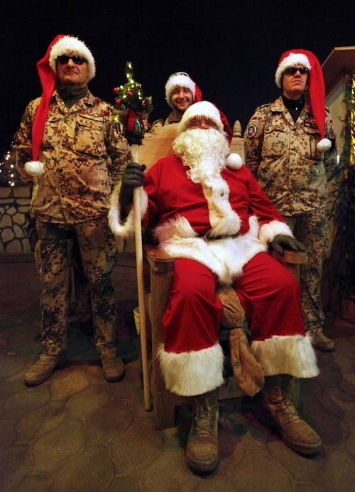 German Bundeswehr army soldiers are dressed as Santa Claus as they attend a Christmas tombola at Camp Marmal in Mazar-e-Sharif
